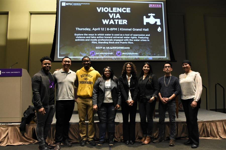 The panelists at the Violence Via Water event in Kimmel Grand Hall pose for a photo.