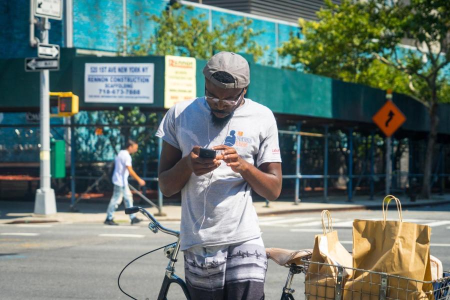 A man wears headphones in Kips Bay.