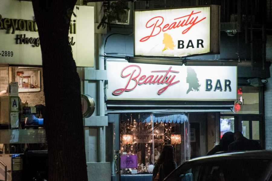 At Beauty Bar on 14th Street, you can get a drink and a manicure – at the same time. (Photo by Sam Klein)