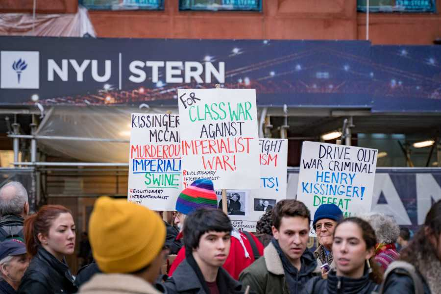 Activists protest against NYU hosting an event at Stern featuring former Secretary of State Henry Kissinger. (Photo by Tony Wu)