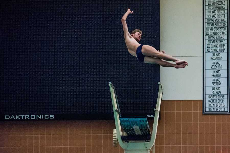 First-year Cole Vertin dives in a win against West Chester University of Pennsylvania on Oct. 6. (Photo by Sam Klein)