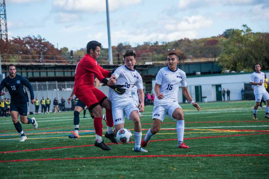 Oliver Kleban forces his way around the opposing goalkeeper before scoring in the final minute of a 2018 game against Brandeis University. (Photo by Sam Klein)