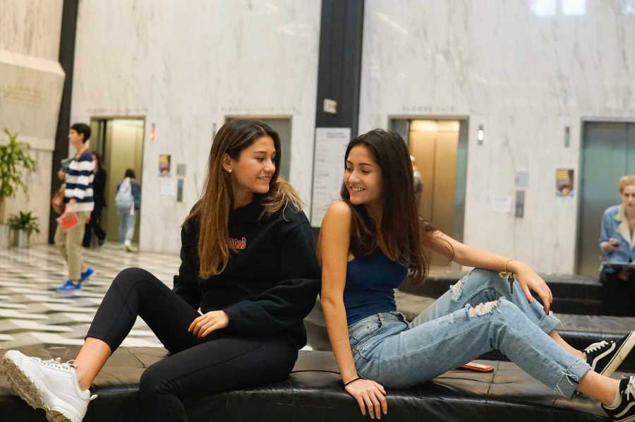 Twin sisters Angela (left) and Emily (right) in the Bobst Library. (Photo by Elaine Chen)