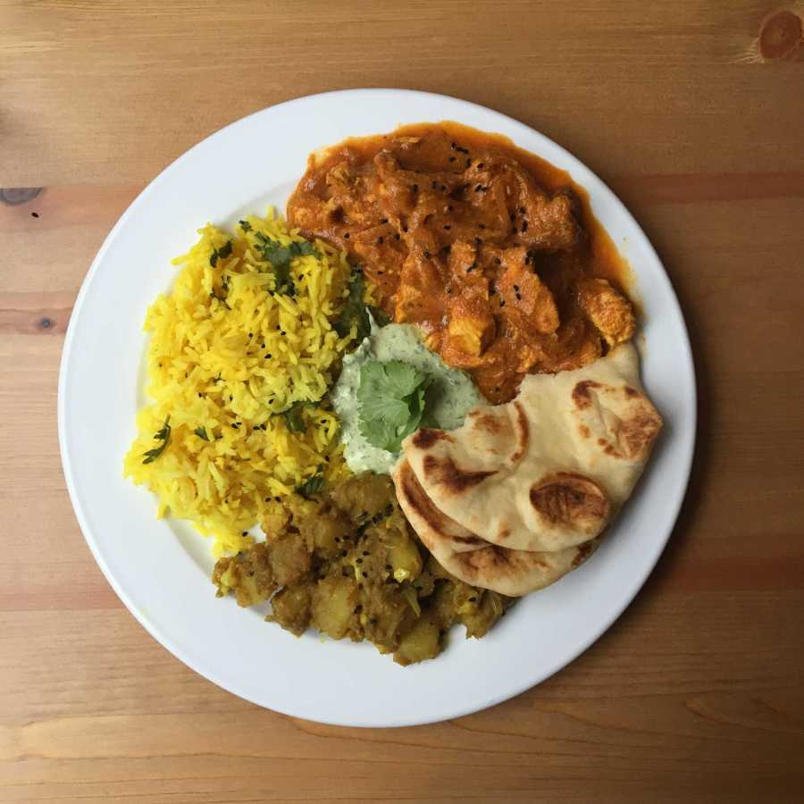 Aloo+Gobi%2C+Chicken+Tikka+Masala%2C+chutney+and+rice+on+a+plate.+%28Photo+by+Andrew+Ankersen%29