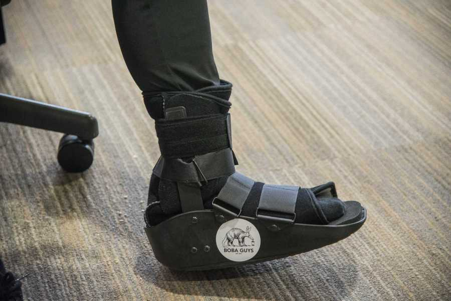 After injuring his foot tap dancing in his room, Mark Yokoyama put a Boba Guys sticker on his walking boot. (Photo by Sam Klein)