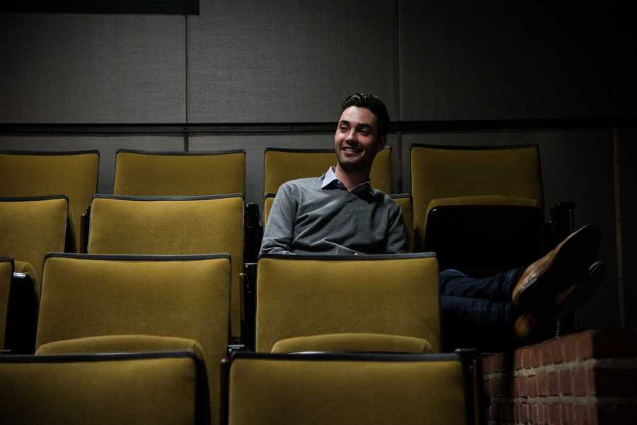 """Tim Sebastian in a classroom in the Tisch building. Sebastian is the producer for Tisch New Theatre, most recently working on a production of """"Next to Normal."""" (Photo by Sam Klein)"""
