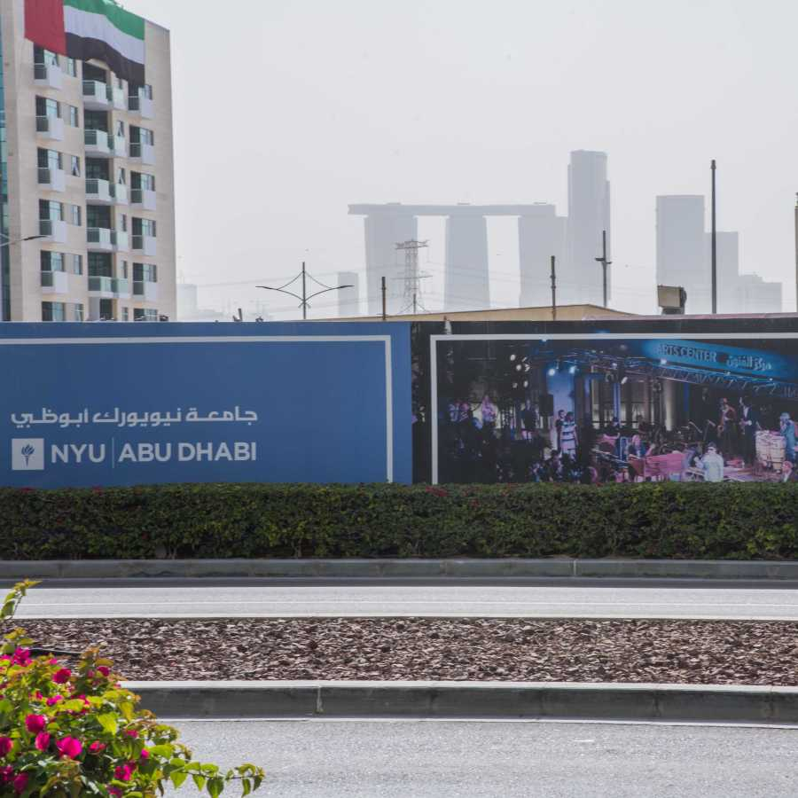 Construction on the NYU Abu Dhabi campus with the city skyline in the background. (Photo by Sam Klein)