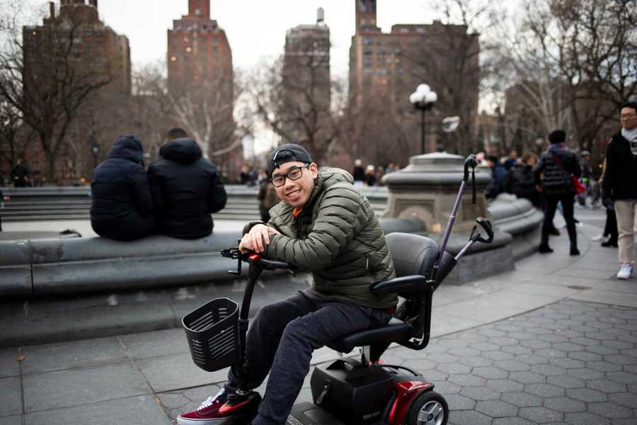 Brian Cheng is a Tisch sophomore, studying Film & TV. He was born with cerebral palsy and had been using a wheelchair to help him move around his entire life. For Cheng, navigating NYU's Washington Square campus can be challenging when it comes to older buildings with worse wheelchair accessibility. (Photo by Katie Peurrung)