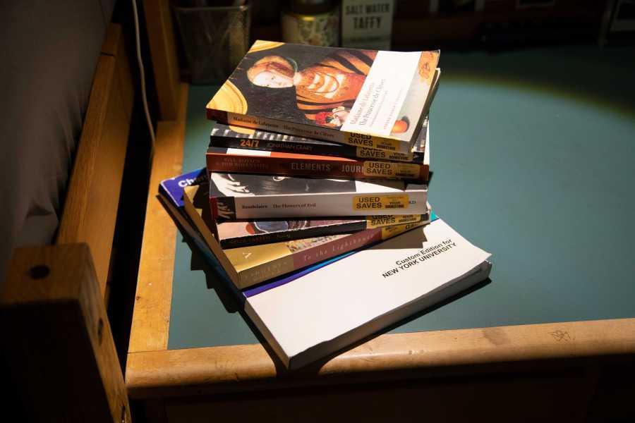 Textbooks from CAS first-year Anna Nuratova's dorm. (Photo by Alina Patrick)