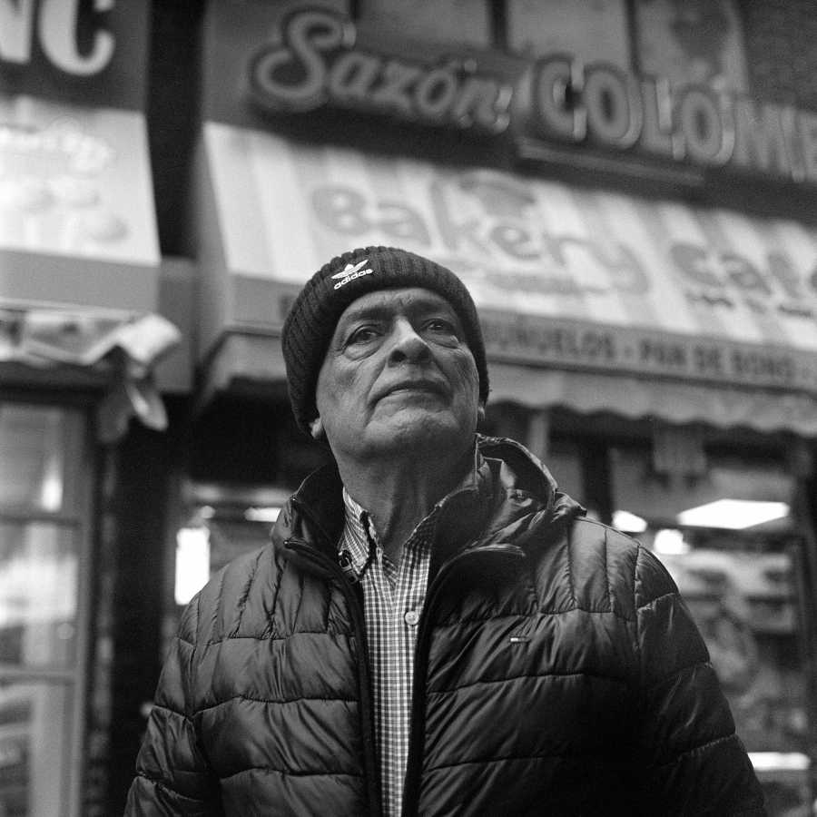I saw him walking down the street and asked to take his portrait. He said he didn't speak English, but when I repeated the question in Spanish he laughed a bit and agreed to let me take his picture.