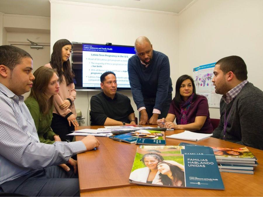 Guilamo-Ramos and his team at the Center for Latino Adolescent and Family Health discuss the Families Talking Together Program. (Courtesy of Dr. Vincent Guilamo Ramos)