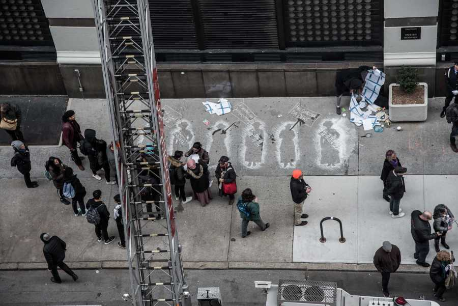 Chalk outlines on Washington Place memorialized the 108th anniversary of the Traingle Shirtwaist Factory fire on Monday. The fire was one of the deadliest industrial disasters in U.S. history. (Photo by Sam Klein)