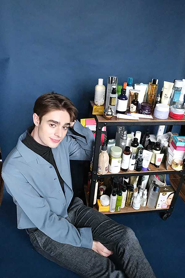 Neiley poses next to a shelf loaded with his favorite skincare products, many of which are Korean. (Photo by Jorene He)