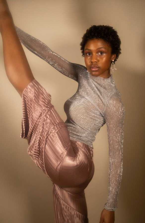 EYES ON THE PRIZE | Imani wearing Urban Outfits Silver sheer mock neck long-sleeved top and Boohoo pleated blush pink wide leg cropped gauchos.(Photo by Katie Peurrung)