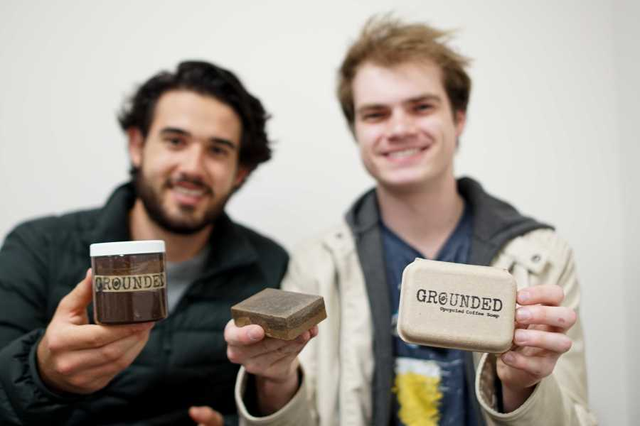 Gallatin senior Parker Reposa (left) and Stern junior Drew Enyedi (right,) founders of the up-cycling company Grounded, display their handmade face mask and soap. All of their products are made from recycled coffee grounds. (Staff photo by Min Ji Kim)