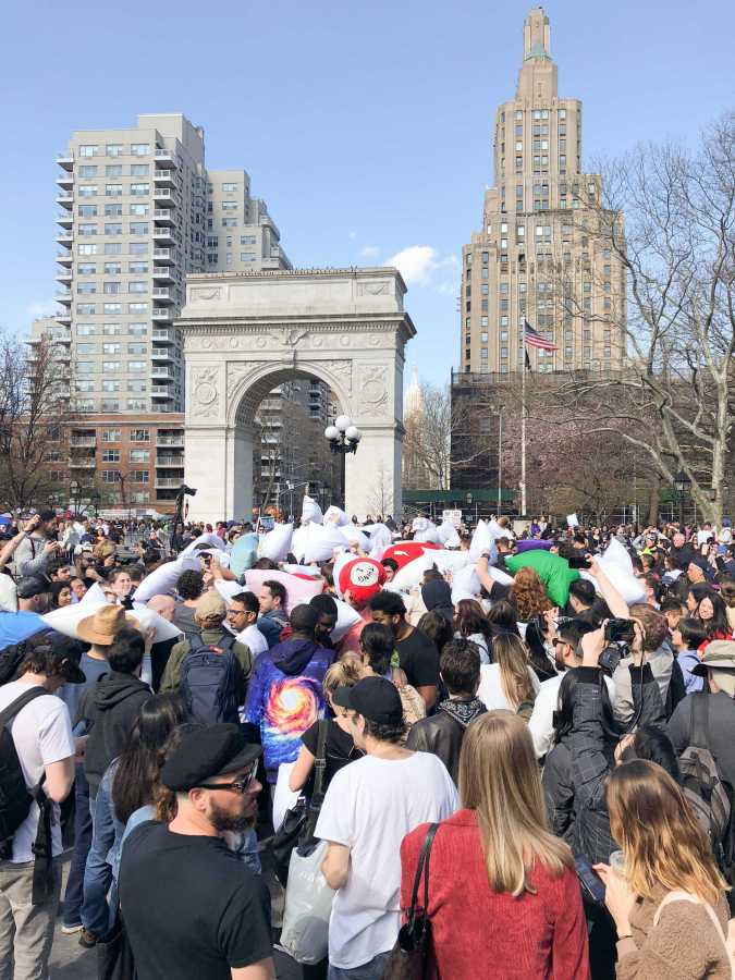Participants battle and bystanders watch the yearly pillow fight in Washington Square Park. (Staff Photo by Calais Watkins)