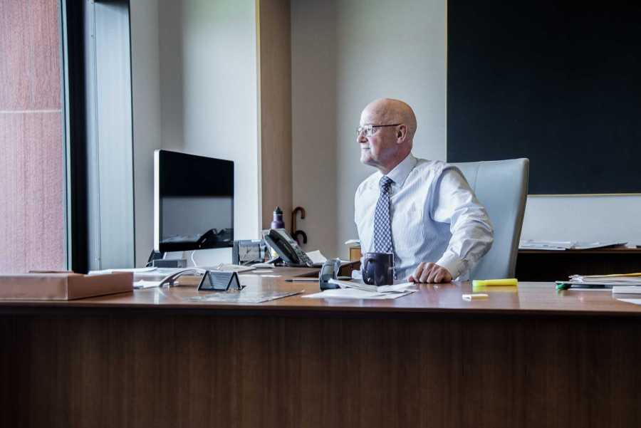 NYU President Andrew Hamilton at his desk in his Bobst office.
