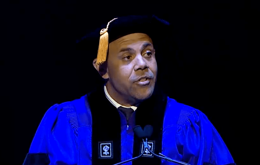 Journalist Steven William Thrasher speaks at the GSAS doctoral convocation on Monday. (via NYU)