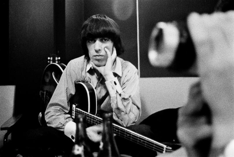Former Rolling Stone bassist Bill Wyman pictured with instrument. (via Susan Norget Film Promotion)