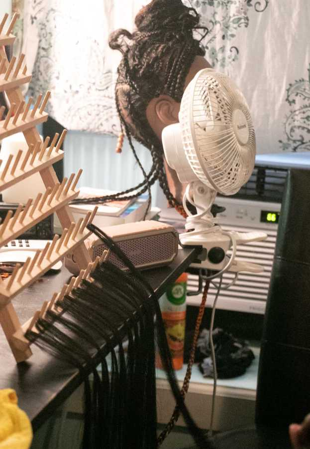 Hair products and extensions fill Ashley Hart's workspace. (Staff Photo by Marva Shi)