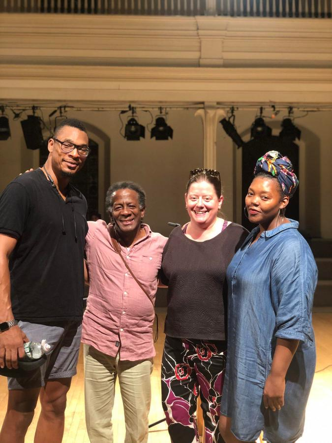 Mahogany L. Browne (right), author of Black Girl Magic and a reader for the event, stands with the founders of Immigrant Families together. (via Twitter)