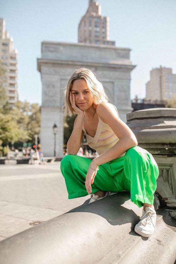 First-year Gallatin student and YouTuber Lucy McFadin poses at Washington Square Park. (Photo by Taylor Krase)