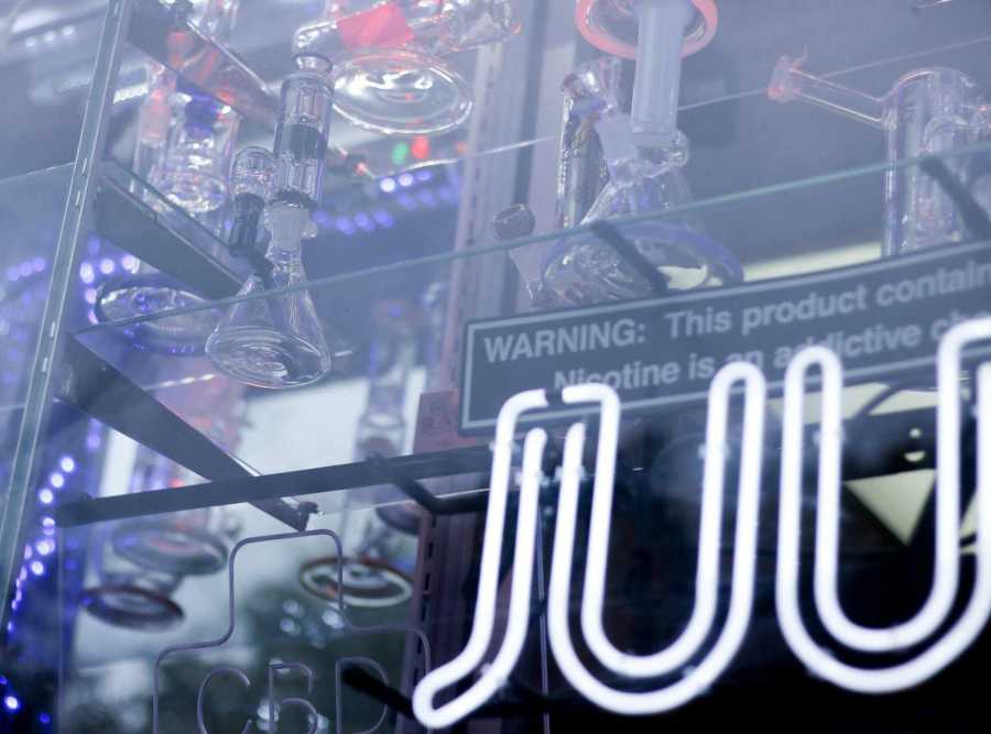 The exterior of a shop displays an illuminated JUUL sign, one of the most popular electronic cigarette brands. (Photo by Alex Tran)