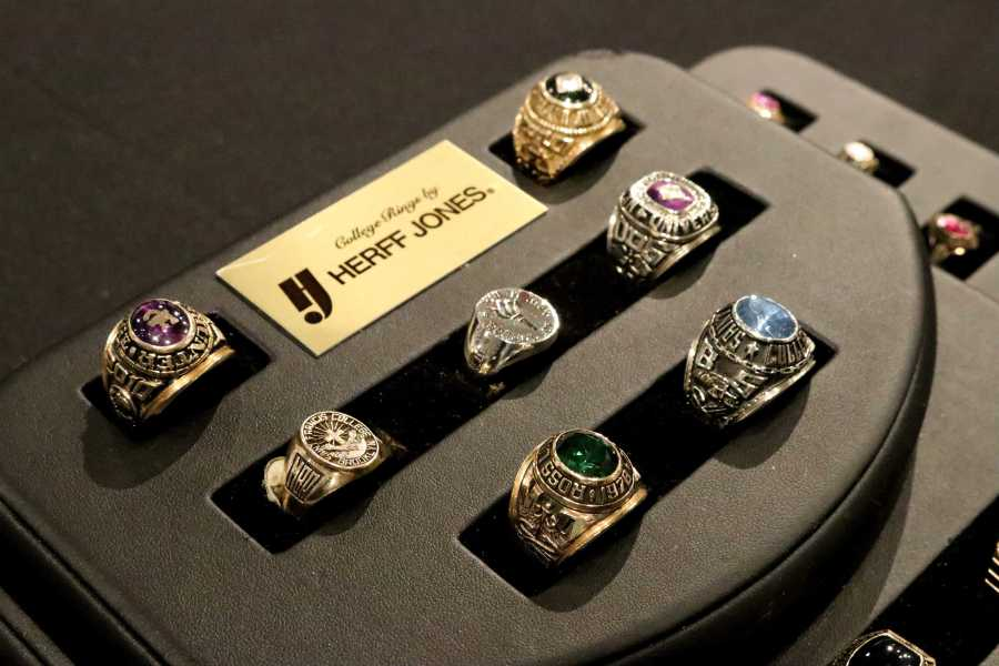NYU class rings are displayed in the NYU Bookstore. Each one retails for around $400. (Photo by Talia Rose Barton)