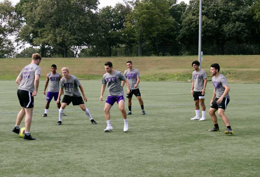 The NYU Men's soccer team warming up at a practice on Randall's Island. (Staff Photo by Marva Shi)