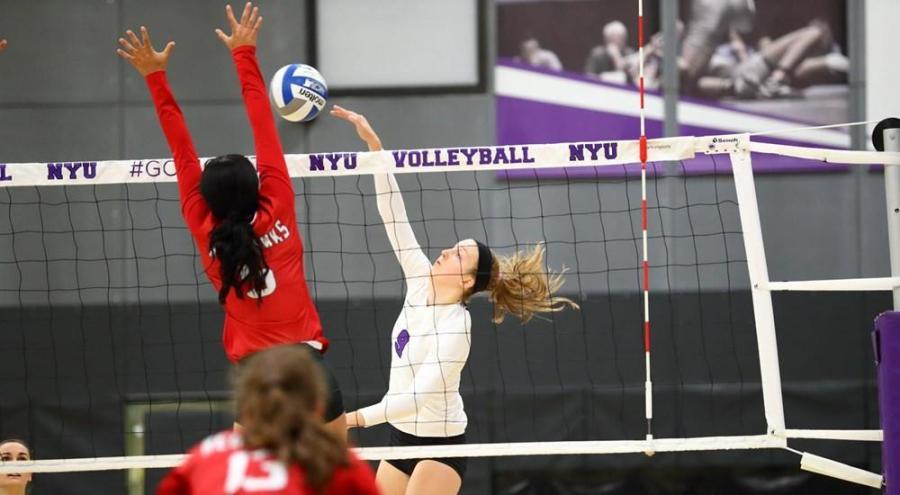 Stern freshman Haley Holz spikes the ball over the net during a match against SUNY Cortland. (Via NYU Athletics)