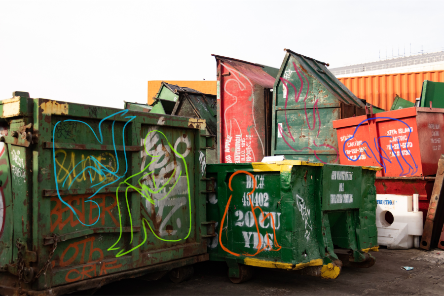 Dumpsters stacked haphazardly on top of other dumpsters near the Newtown Creek Wastewater Treatment Plant.
