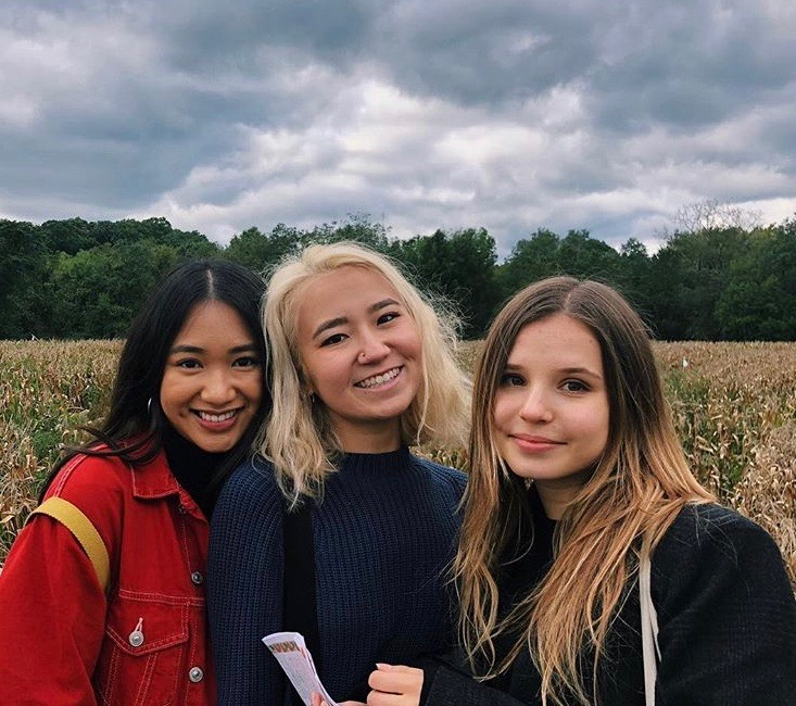 CAS juniors Lise Swain and Han Nguyen posing for a picture with sophomore Kathrine Serebrianski. The trio became friends after an outing in Smorgasburg, and now are inseparable as roommates. (Photo by Kritima Lamicchane)