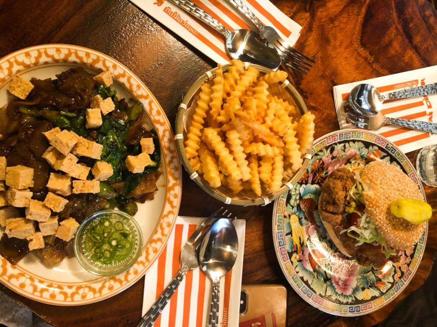 The Fried Chicken Sandwich and Phat See Eiw are both served by Uncle Boons. This new Asian-fusion restaurant is located in Little Italy. (Photo by Ria Mittal)