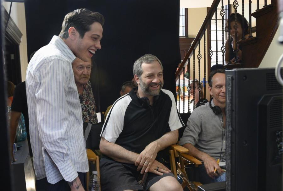(From left) Pete Davidson and director Judd Apatow with crew members on the set of The King of Staten Island. (Photo by Kevin Mazur / Courtesy of Universal Pictures)