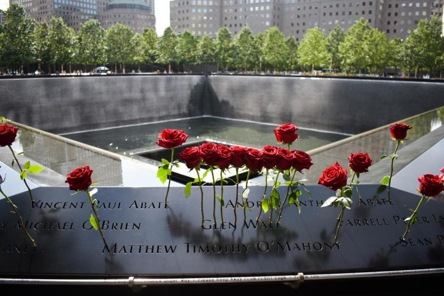 19 years after the national tragedy of September 11 2001, Americans are facing another national crisis — the COVID-19 pandemic. The 9/11 memorial still saw many visitors, albeit masked and somewhat socially distanced. (Staff Photo by Trace Miller)