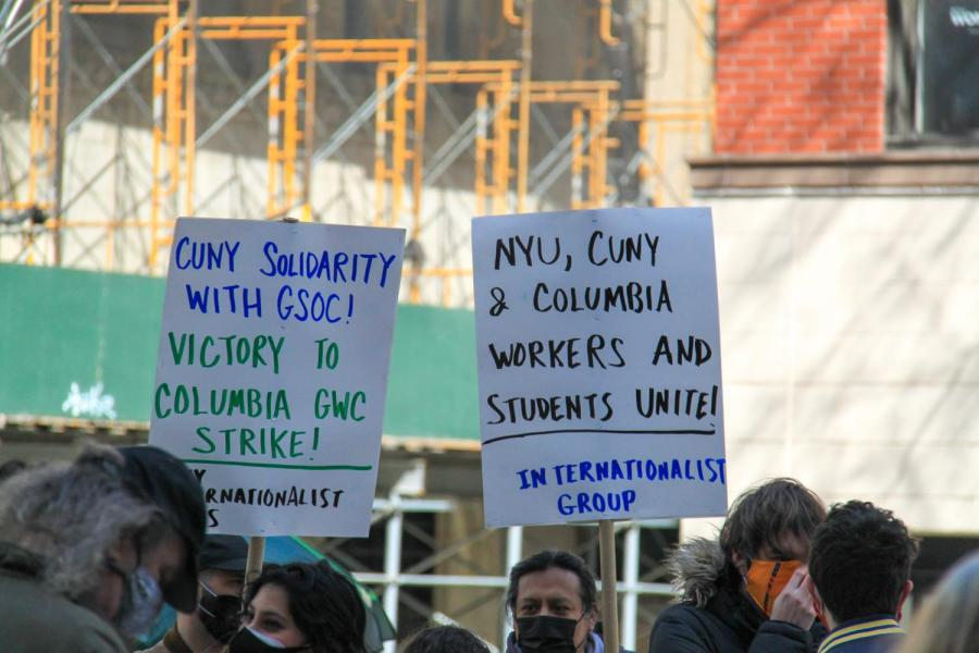 Rally-goers held signs in support of GSOC. (Staff Photo by Alexandra Chan)