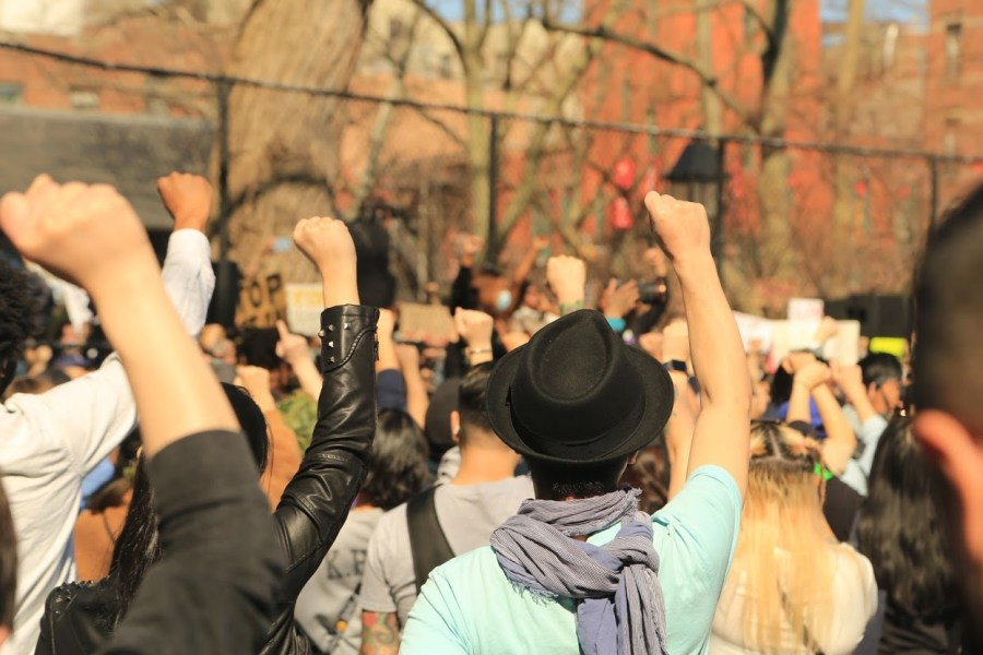 Many people at the rallies in New York City raise their fist in solidarity. (Photo by Suhail Gharaibeh)