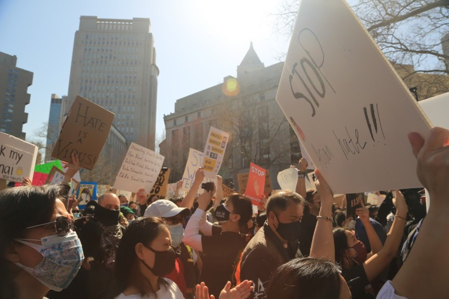 Many people gathered with signs to bring awareness to anti-Asian violence. (Photo by Suhail Gharaibeh)
