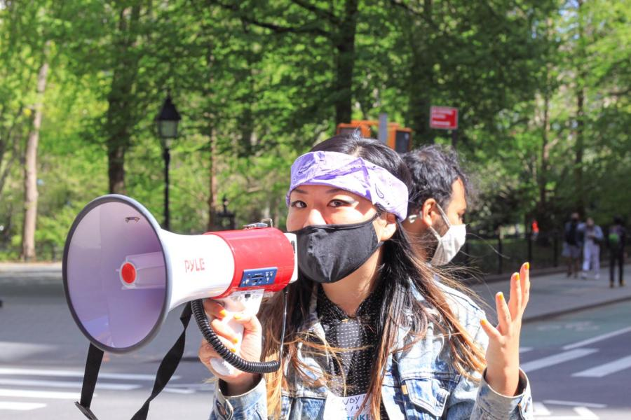 GSOC member leads slogans with a megaphone.