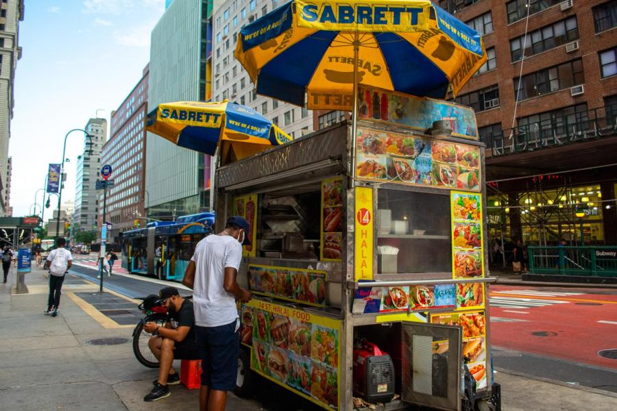 Many halal carts cluster around Union Square. Halal carts offer a heaping to-go container of seasoned rice piled with the meat or vegetables of your choice for five or six dollars, making it an ideal cheap-eats meal. (Staff Photo by Manasa Gudavalli)