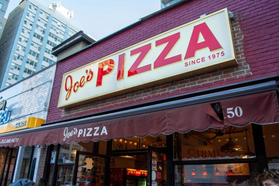 Joe's Pizza has been attracting New Yorkers and celebrities since the shop's opening in 1975. (Staff Photo by Ryan Kawahara)