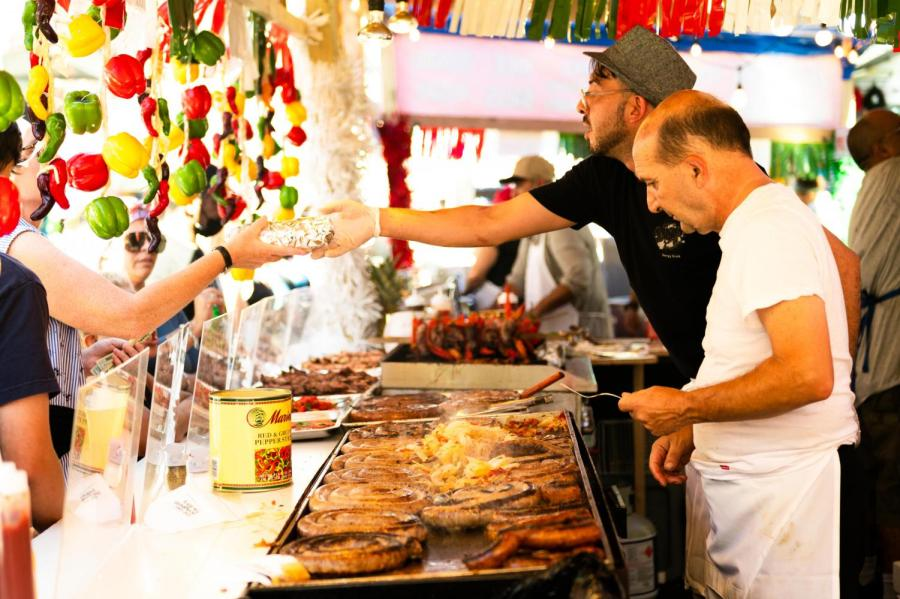 A cook prepares their customer's food at the Annual Feast of San Gennaro. (Staff Photo by Jake Capriotti)