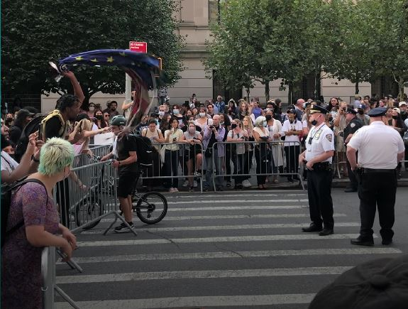 Protestors gather outside the Met Gala. While many of the biggest names in pop culture gathered inside the gallery, police and protestors clashed outside the event. (Photo by Sarah Gil)