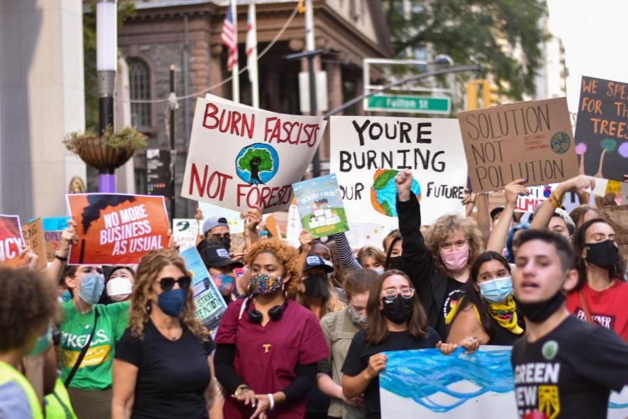 Large crowds of activists take to the streets of Downtown Manhattan.