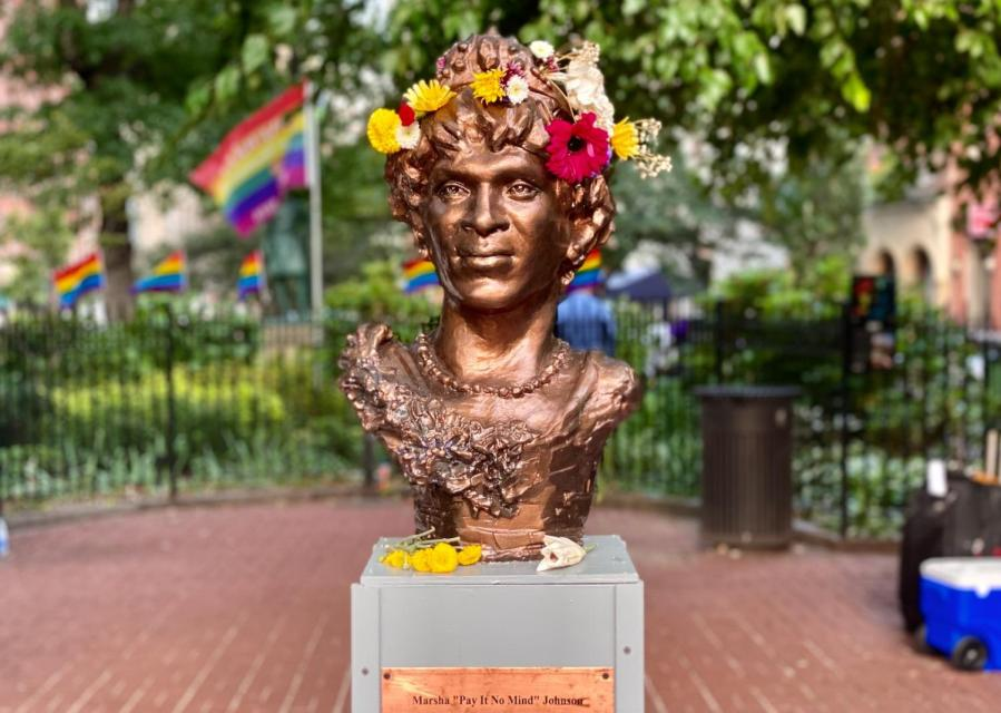 The statue of Marsha P. Johnson, decorated in a wreath and flowers, stands in Christopher Park. This monument honoring the gay liberation pioneer was installed by a local artist without city authorization. (Staff Photo by Sirui Wu)