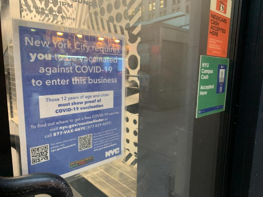 A sign outside a restaurant near campus tells patrons that they must be vaccinated to be served. However, many NYU students have reported that local businesses are not complying with Mayor DeBlasio's mandate. (Staff Photo by Jake Capriotti)
