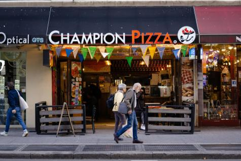 Champion Pizza is a renowned New York restaurant with locations in Soho and on 5th Avenue. Hazzi Akdeniz, its founder, wants to give back to the homeless community by donating money and pizza. (Photo by Kevin Wu)