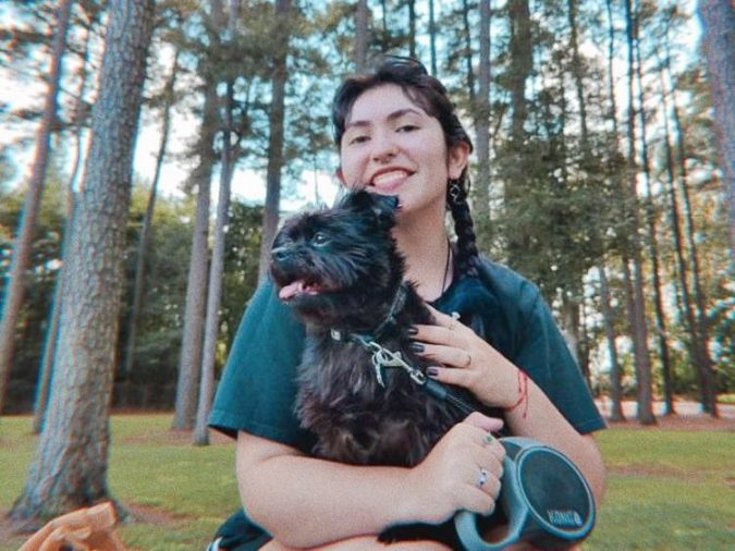 Gallatin sophomore Tara Shear enjoys some quality time outside with her emotional support dog Dakota. NYU students who meet certain criteria are permitted to keep pets in dorms for emotional support. (Image courtesy of Tara Shear)