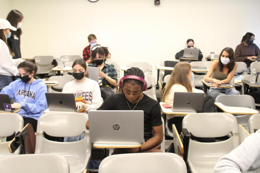 Students in a classroom attend in-person classes with limited safety precautions. NYU needs to provide virtual class options for students who cannot attend campus due to COVID restrictions. (Photo by Manaal Shareh)