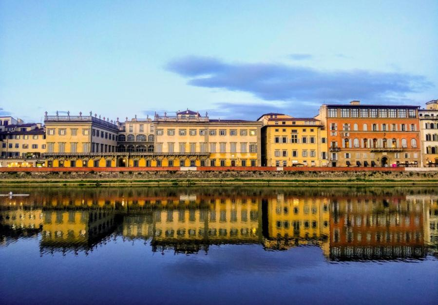 The Arno river cuts through the city of Florence, the site of NYU's campus in Italy. NYU's limits on off-campus student housing options diminish financial accessibility at abroad locations — and impede students from fully experiencing their global study experience. (Staff Photo by Arnav Binaykia)